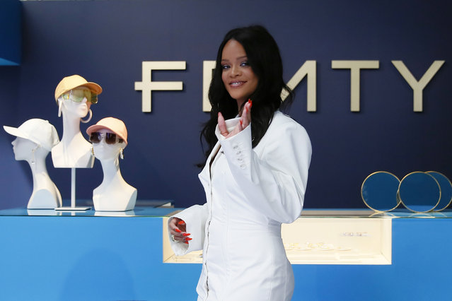 Singer Rihanna, the first black woman in history to head up a major Parisian luxury house, poses as she unveiled her first fashion designs for Fenty at a pop-up store in Paris, France, Wednesday, May 22, 2019. The collection, named after the singer turned designer's last name, comprises ready-to-wear, footwear, accessories, and eyewear and is available for sale Paris' Le Marais area from Friday and will debut online May 29. (Photo by Francois Mori/AP Photo)