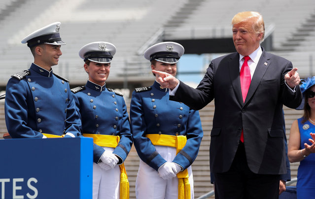U.S. President Donald Trump gestures at cadets as he participates in graduation ceremonies at the U.S. Air Force Academy commencement in Colorado Springs, Colorado, U.S., May 30, 2019. (Photo by Jonathan Ernst/Reuters)