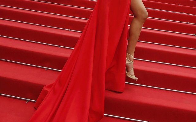"""The shoes and the dress of a guest is pictured as she poses on the red carpet during arrivals for the screening of the film """"Macbeth"""" in competition at the 68th Cannes Film Festival in Cannes, southern France, May 23, 2015. (Photo by Regis Duvignau/Reuters)"""