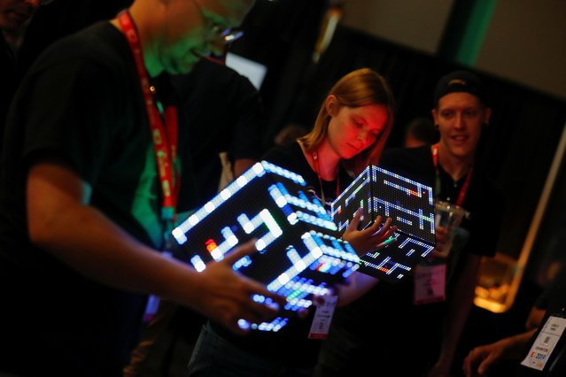 Attendees try out new gaming hardware called Pixxelcube as it makes its world debut during opening day of E3, the annual video games expo revealing the latest in gaming software and hardware in Los Angeles, California, U.S., June 11, 2019. (Photo by Mike Blake/Reuters)