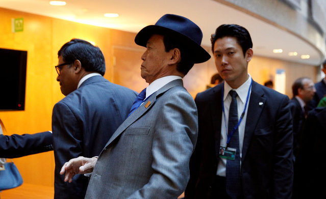 Japanese Finance Minister Taro Aso (C) arrives for the G20 Finance Ministers and Central Bank Governors meeting during the IMF and World Bank spring meetings in Washington April 15, 2016. (Photo by Kevin Lamarque/Reuters)