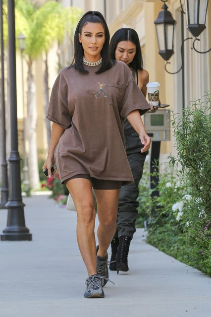 Kim Kardashian leaves a meeting in Calabasas, CA on June 25, 2019 with an assistant as she rocks an oversized Travis Scott tour t-shirt and Adidas Yeezys. (Photo by Backgrid USA)