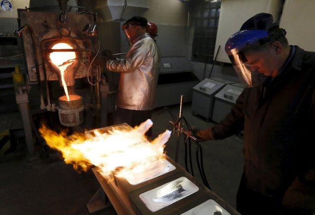 Melters cast ingots of 99.99 percent pure silver at the Krastsvetmet Krasnoyarsk non-ferrous metals plant in the Siberian city of Krasnoyarsk, Russia, June 5, 2015. Krastsvetmet is one of the world's largest players in the precious metals industry. REUTERS/Ilya Naymushin