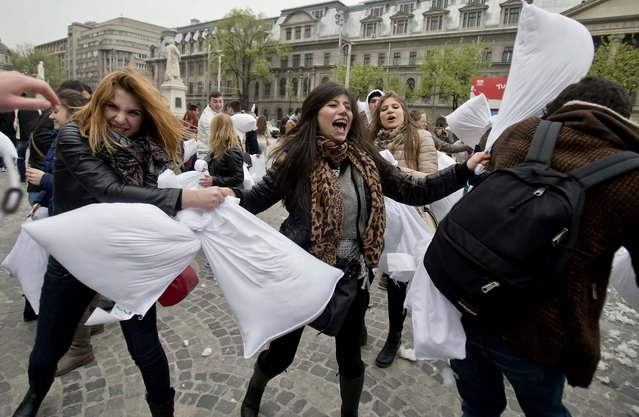 People engage in a pillow fight in Bucharest, Romania.  (Photo by Vadim Ghirda/Associated Press)