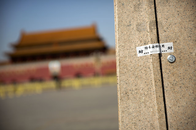 In this Friday, March 10, 2017 photo, an anti-tampering security sticker seals a panel at the base of a light pole on Tiananmen Square near the Great Hall of the People before a plenary session of the Chinese People's Political Consultative Congress (CPPCC) in Beijing. (Photo by Mark Schiefelbein/AP Photo)