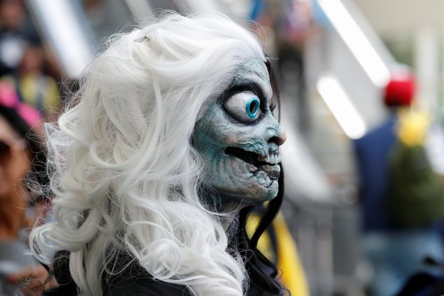 An attendee arrives in a costume to enjoy Comic Con International in San Diego, California, U.S., July 19, 2019. (Photo by Mike Blake/Reuters)