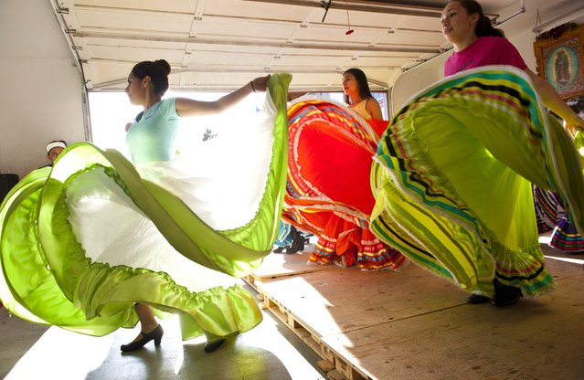 In this April 25, 2016 photo, Chiquillas Folklorico Ballet's Norma Arceo, left, leads her dancers Jackie Medina, right, in a routine during dance practice at Norma's home in Walla Walla, Wash. They are dancing in preparation for a event next week. (Photo by Michael Lopez/Walla Walla Union-Bulletin via AP Photo)