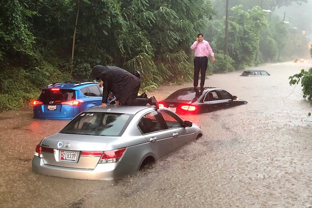 Motorists are stranded on a flooded section of Canal Road in Washington during a heavy rainstorm, Monday, July 8, 2019. (Photo by Dave Dildine/WTOP via AP Photo)