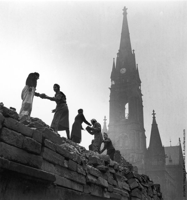 Women form a human chain to carry bricks used in the reconstruction of Dresden, March 1946, after allied bombing had destroyed the city in February 1945