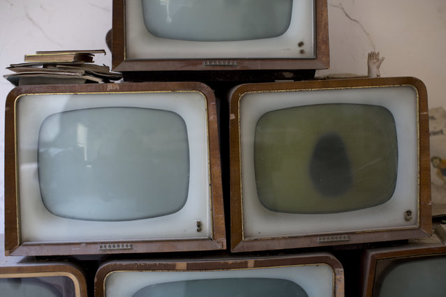 Old televisions found and collected by soldiers are seen in an abandoned commercial area in the United Nations buffer zone in central Nicosia March 12, 2014. (Photo by Neil Hall/Reuters)