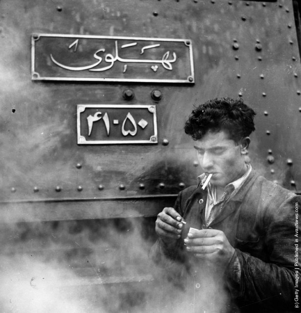 1955:  A railway engineer resting for a cigarette at Zagheh in the Luristan mountains of West Central Persia