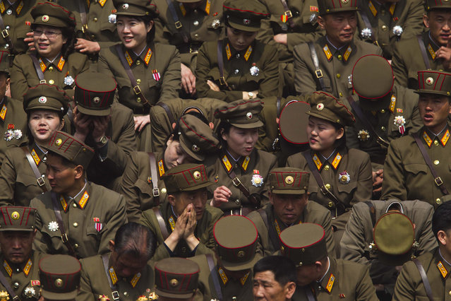 A crowd of North Korean military members wait for a mass meeting of North Korea's ruling party to start at a stadium in Pyongyang on Saturday, April 14, 2012. (Photo by David Guttenfelder/AP Photo)