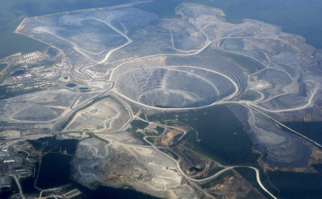 An aerial view from a plane shows the Olimpiada gold operation, owned by Polyus Gold International company, in Krasnoyarsk region, Eastern Siberia, Russia, July 1, 2015. (Photo by Ilya Naymushin/Reuters)