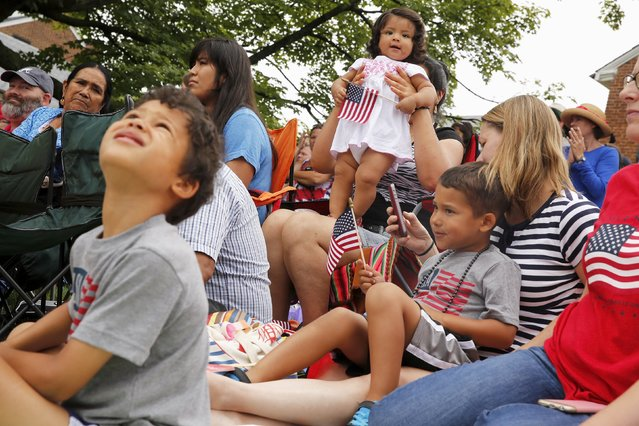 Spectators watch the Independence Day Parade in Fairfax, Virginia July 4, 2015. (Photo by Jonathan Ernst/Reuters)