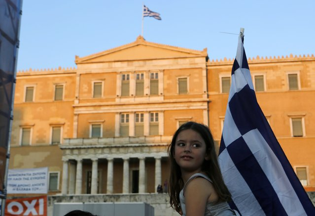 A girl takes part in a rally organized by supporters of the No vote in Athens, Friday, July 3, 2015. (Photo by Petros Karadjias/AP Photo)