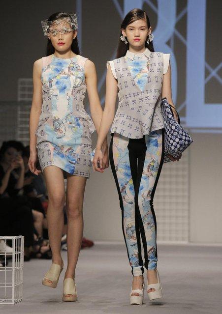 Models present creations by Hong Kong designer Walter Kong during the Spring/Summer fashion week in Hong Kong, Monday, July 6, 2015. (Photo by Vincent Yu/AP Photo)