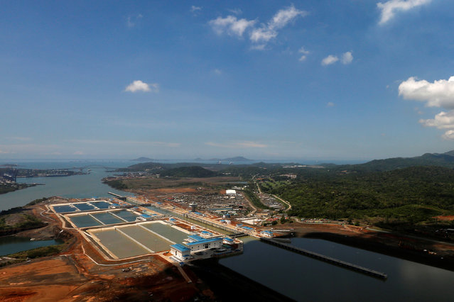 An aerial view of the new Panama Canal expansion project on the Atlantic side of the Panama Canal during an organized media tour by Italy's Salini Impregilo, one of the main sub contractors of the Panama Canal Expansion project, in Panama City May 11, 2016. The newly expanded Panama Canal will be inaugurated on June 26, 2016. (Photo by Carlos Jasso/Reuters)