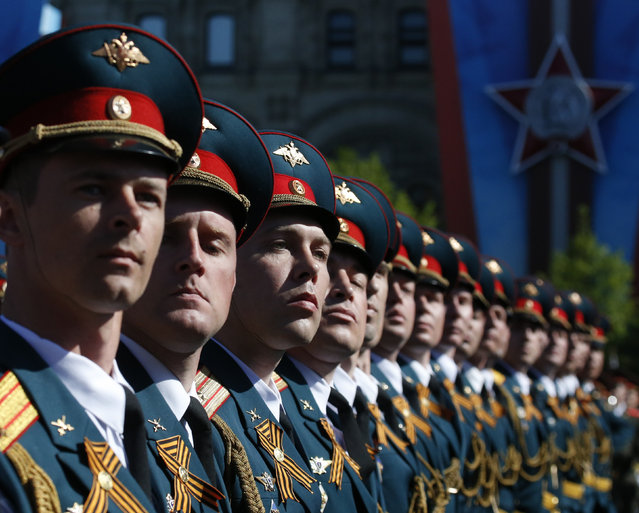 Russian servicemen march during the Victory Day parade in Moscow's Red Square May 9, 2014. (Photo by Grigory Dukor/Reuters)