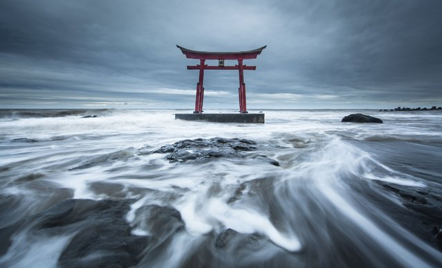 """Torrent"". ""Torii"" built as a marine guardian deity. It is a building which symbolizes Japan. A long time ago, there is a legend that the wreck at sea decreased greatly, thanks to this torii. Photo location: Shosanbetsu,Hokkaido, Japan. (Photo and caption by Mitsuhiko Kamada/National Geographic Photo Contest)"