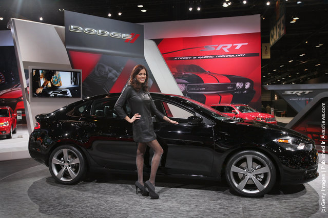 Julie Etheridge helps Dodge show off the new Dart during the media preview of the Chicago Auto Show