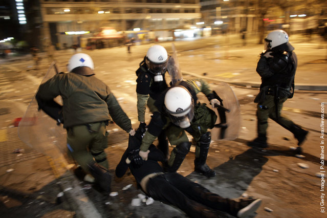 Police arrest a protestor in the streets during a demonstration against the new austerity measures on February 12, 2012 in Athens, Greece