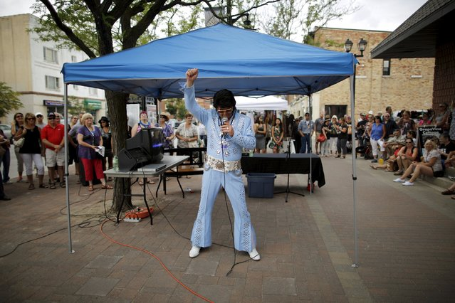 Elvis Presley tribute artist Gordie McNeil of Fort Erie, Ontario performs on a sidewalk during the four-day Collingwood Elvis Festival in Collingwood, Ontario July 25, 2015. (Photo by Chris Helgren/Reuters)