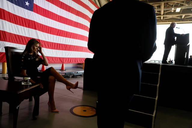 U.S. first lady Melania Trump sits at the side of the stage as her husband President Donald Trump rallies with service members at Sigonella Air Force Base at Naval Air Station Sigonella at the end of Trump's participation in the G7 summit in Sicily, Italy May 27, 2017. (Photo by Jonathan Ernst/Reuters)