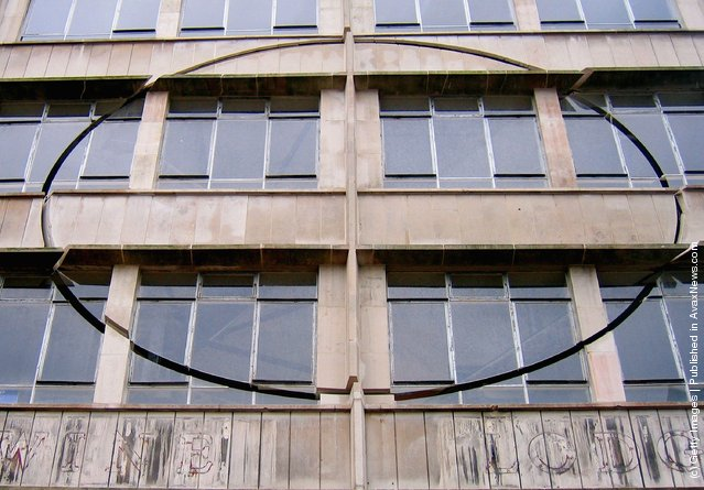 An installation by the artist Richard Wilson, entitled 'Turning the Place Over', is built into the condemned Cross Keys House in Moorfields as part of the Capital of Culture for 2008