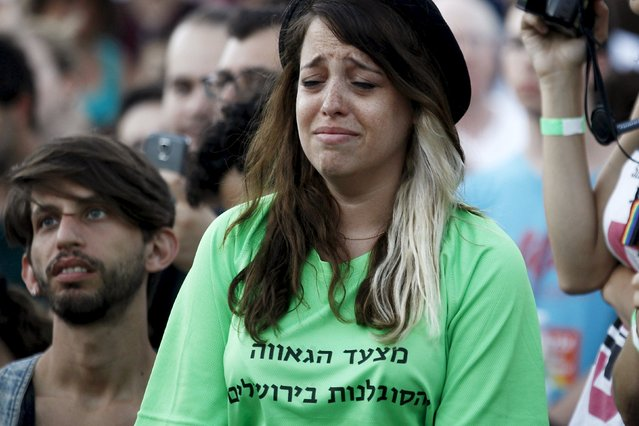 "A participant of an annual gay pride parade reacts after an Orthodox Jewish assailant stabbed and injured six participants in Jerusalem on Thursday, police and witnesses said July 30, 2015. The words printed on the t-shirt in Hebrew read, ""The Pride and Tolerance Parade"". (Photo by Amir Cohen/Reuters)"