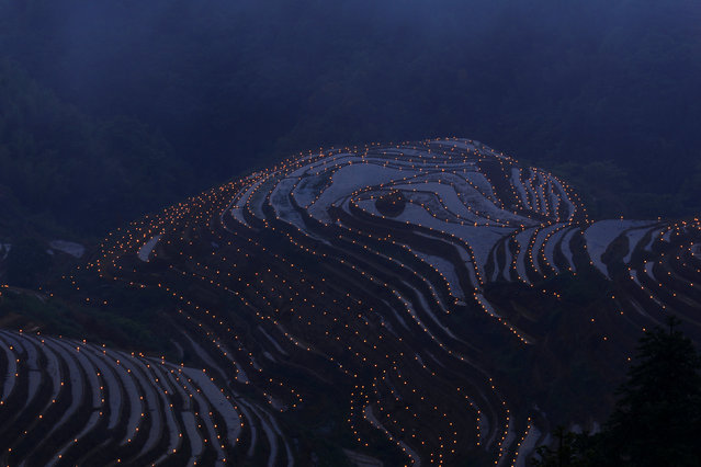 Thousands of torches are placed in terraced fields by villagers during a local festival praying for good harvest at Guilin, Guangxi Zhuang Autonomous Region, China June 3, 2017. (Photo by Reuters/Stringer)