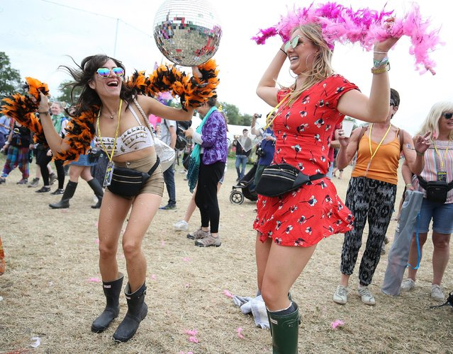 Festival goers dance during Glastonbury Festival at Worthy Farm, near Pilton, Somerset, Britain, 23 June 2017. The outdoor festival runs from 21 to 25 June. (Photo by Nigel Roddis/EPA)