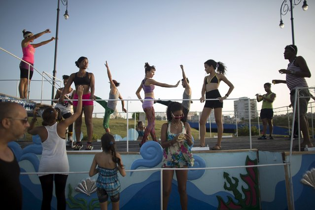 Revellers perform during a training session for a carnival which starts next Friday, Havana, August 5, 2015. This year's carnival is dedicated to the 495th anniversary of the city. (Photo by Alexandre Meneghini/Reuters)