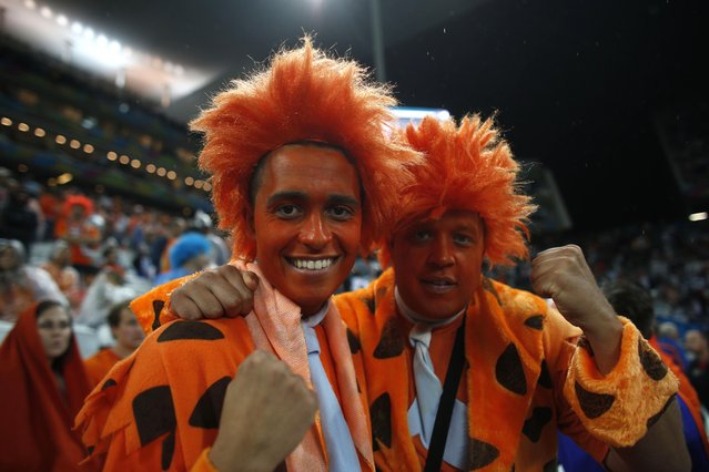 Dutch fans pose for a photo during the halftime of the semifinal match between Argentina and The Netherlands at the Itaquerao stadium during the 2014 soccer World Cup in Sao Paulo, Brazil, Wednesday, July 9, 2014. (Photo by Dario Lopez-Mills/AP Photo)