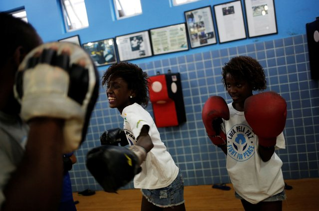 Children practice during an exercise session at a boxing school, in the Mare favela of Rio de Janeiro, Brazil, June 2, 2016. (Photo by Nacho Doce/Reuters)