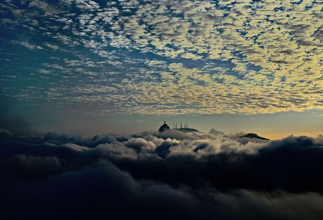 The Christ the Redemer statue is seen atop Corcovado Hill in Rio de Janeiro, Brazil on July 3, 2014. (Photo by Carl de Souza/AFP Photo)