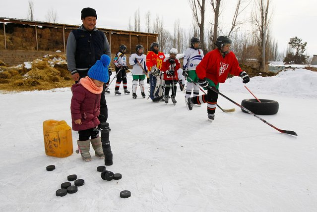 Coach Salamat Abdyrakhmanov and members of Kyrgyzstan's first female hockey team attend a training session in the village of Otradnoye, Kyrgyzstan on February 4, 2020. (Photo by Vladimir Pirogov/Reuters)