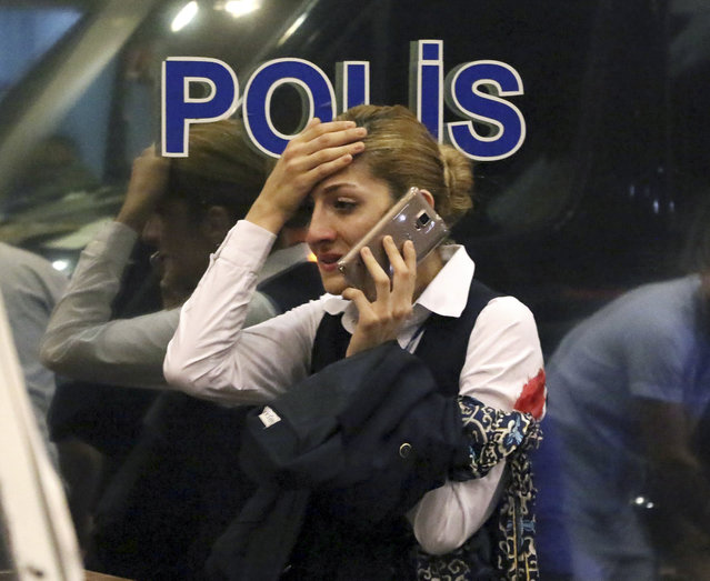 A woman reacts outside Istanbul's Ataturk airport, Tuesday, June 28, 2016. Suspected Islamic State group extremists have hit the international terminal of Istanbul's Ataturk airport, killing dozens of people and wounding many others, Turkish officials said Tuesday. Turkish authorities have banned distribution of images relating to the Ataturk airport attack within Turkey. (Photo by DHA via AP Photo)