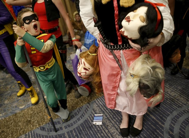 """William Camp dressed up as """"Robin"""" yawns while waiting in line for the start of the costume contest at Wizard World Comic Con in Chicago, Illinois, United States, August 22, 2015. (Photo by Jim Young/Reuters)"""