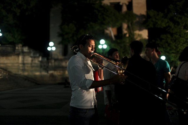 Student of the National School of Music David Navarro, 16, practices with his trumpet before performing at a public demonstration in support of Venezuela's government in Havana, March 15, 2015. (Photo by Alexandre Meneghini/Reuters)