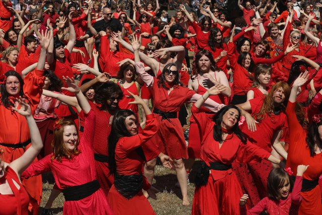 """Both men and women dressed as singer Kate Bush from her 1978 video to her song """"Wuthering Heights"""" dance while seeking to create a new world's record for the most people dancing in costume to the song at once at Tempelhofer Feld park on July 16, 2016 in Berlin, Germany. (Photo by Sean Gallup/Getty Images)"""