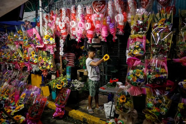 A vendor arranges a flower bouquet a day before Valentines Day in Dangwa Flower Market in Manila, Philippines, February 13, 2020. (Photo by Eloisa Lopez/Reuters)