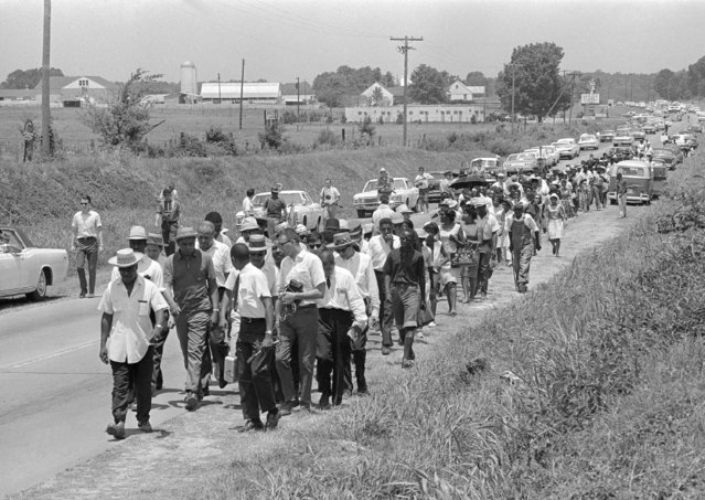 In this June 9, 1966 file photo, civil rights activists led by Dr. Martin Luther King stretch out along Highway 51 south near Senatobia, Miss., on a march to the capital, Jackson, started by James Meredith. The March Against Fear helped many find a voice to protest the injustices of the day. (Photo by AP Photo)
