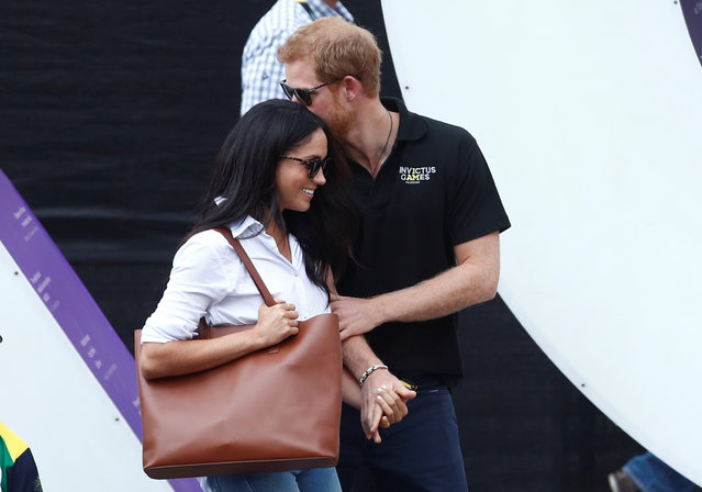 Britain's Prince Harry (R) arrives with girlfriend Meghan Markle at the wheelchair tennis event during the Invictus Games in Toronto, Ontario, Canada September 25, 2017. (Photo by Mark Blinch/Reuters)