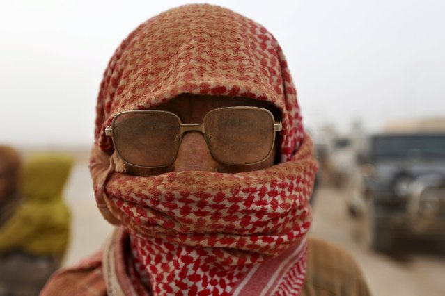 A Syrian refugee man covered with dust arrives at the Trabeel border, after his crossed into Jordanian territory with his family, near the northeastern Jordanian border with Syria, and Iraq, near the town of Ruwaished, east of Amman September 10, 2015. (Photo by Muhammad Hamed/Reuters)