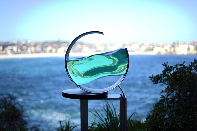 """A sculpture by artist Tsukasa Nakahara is seen as part of the """"Sculpture by the Sea"""" exhibition near Bondi beach in Sydney on October 18, 2017. """"The wave and tide brings various benefits to us and the earth. The repetition will last forever"""". (Photo by Saeed Khan/AFP Photo)"""