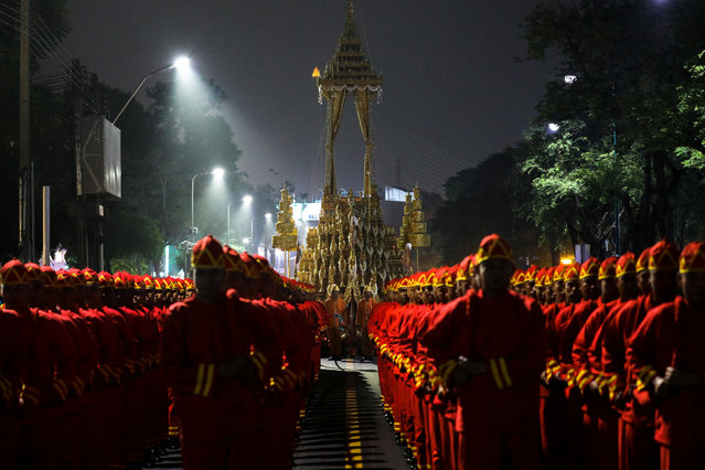 The Great Victory Royal Chariot is pulled by Thai army officials dressed in ancient uniforms in preparation for the Royal Cremation ceremony of ThailandÕs late King Bhumibol Adulyadej near the Grand Palace in Bangkok, Thailand, October 26, 2017. (Photo by Athit Perawongmetha/Reuters)
