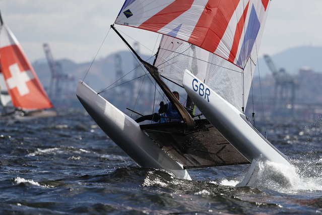 Ben Saxton of Great Britain and Nicola Groves of Great Britain compete in the Nacra 17 Mixed class on Day 6 of the Rio 2016 Olympics at Marina da Gloria on August 11, 2016 in Rio de Janeiro, Brazil. (Photo by Clive Mason/Getty Images)