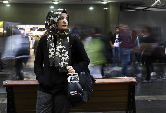 """17-year-old student, female boxer and """"Hafiz"""" Zeynep Gul Caylar waits for the train at a subway station in Ankara Turkey on October 25, 2017. Tevfik Ileri Religious High School's 10th grade student Zeynep Gul Caylar wants to be the champion of Turkey after winning the Ankara championship in the boxing sport that she has been interested in for four years as well as the achievements she has shown in the Holy Quran memorizing training and poetry writing. Because of his interest in foreign languages, Caylar learned Arabic as well as English. She won the first and the third place in two Arabic poetry contests and won sixth place overall in Turkey. """"Hafiz"""", literally meaning """"guardian"""" or """"memorizer"""", depending on the context, is a term used by Muslims for someone who has completely memorized the Qur'an. (Photo by Guven Yilmaz/Anadolu Agency/Getty Images)"""