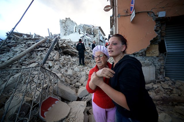 Residents reacts among the rubble after a strong heartquake hit Amatrice on August 24, 2016. (Photo by Filippo Monteforte/AFP Photo)