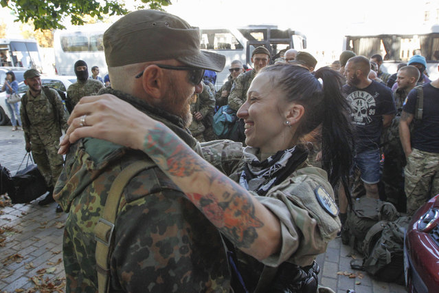 """Volunteers of Ukrainian self-defence battalion """"Azov"""", after they returned from the front line in Eastern regions of Ukraine, in Kiev September 15, 2014. (Photo by Valentyn Ogirenko/Reuters)"""